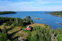 aerial view of house and view east over Penobscot Bay towards Deer Isle